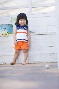 baby-meisje-bloesje-marine-short-oranje
