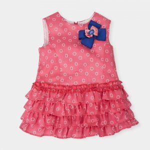 felroze-jurkje-wit-motiefjes-blauw-strikje-rugzijde-ritssluiting